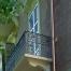 porta balcone a stecca aperta in legno